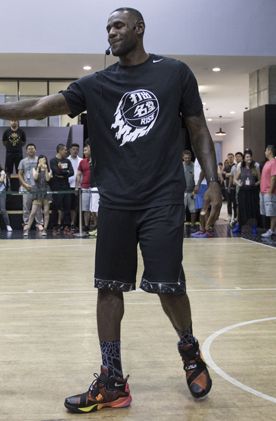 wholesale dealer 817a0 b2292 Lebron James at Nike Rise Event wearing Nike rise Lebron t-shirt and Nike  lebron 9 soldier rise