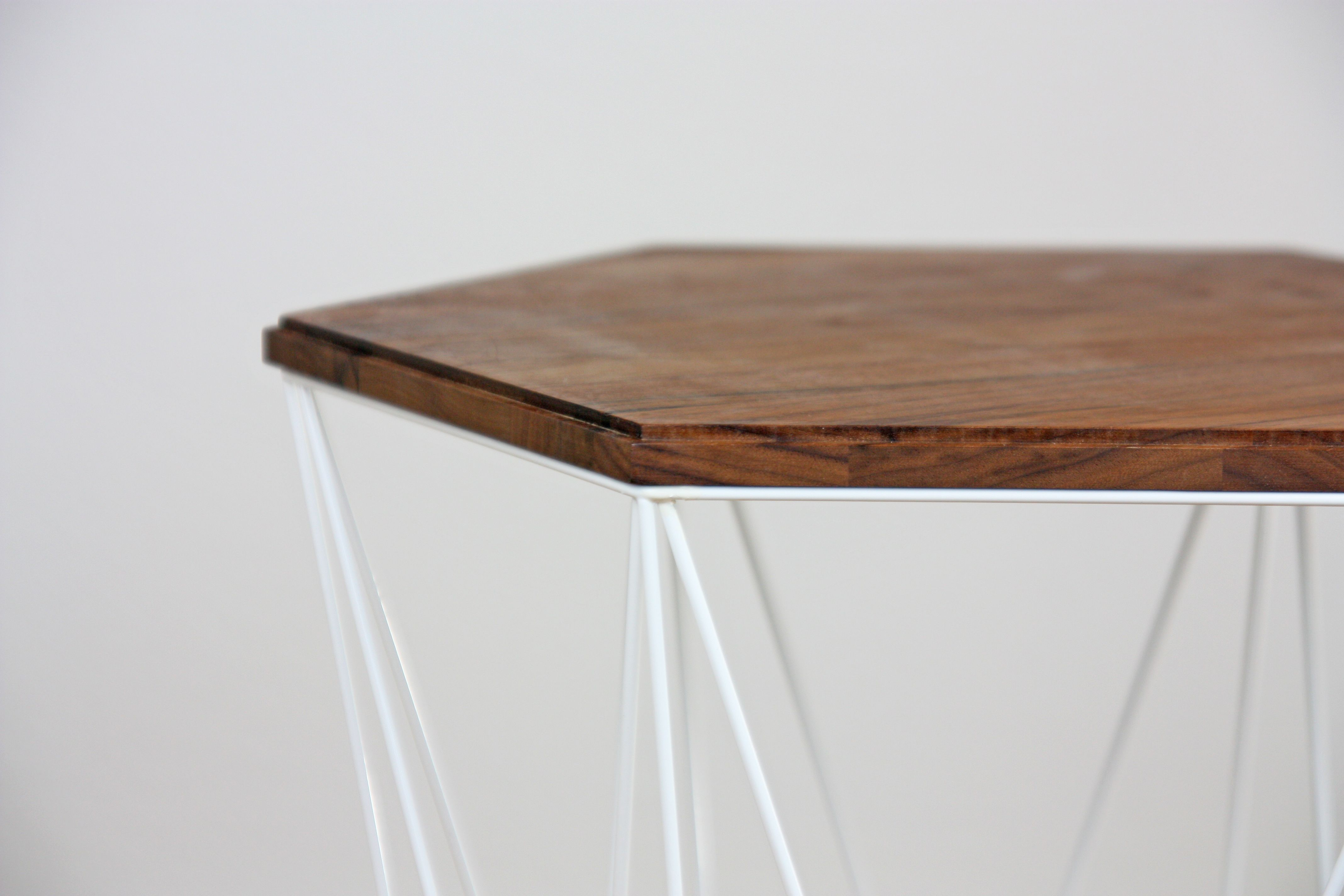 muse side table walnut detail of table top with all round groove