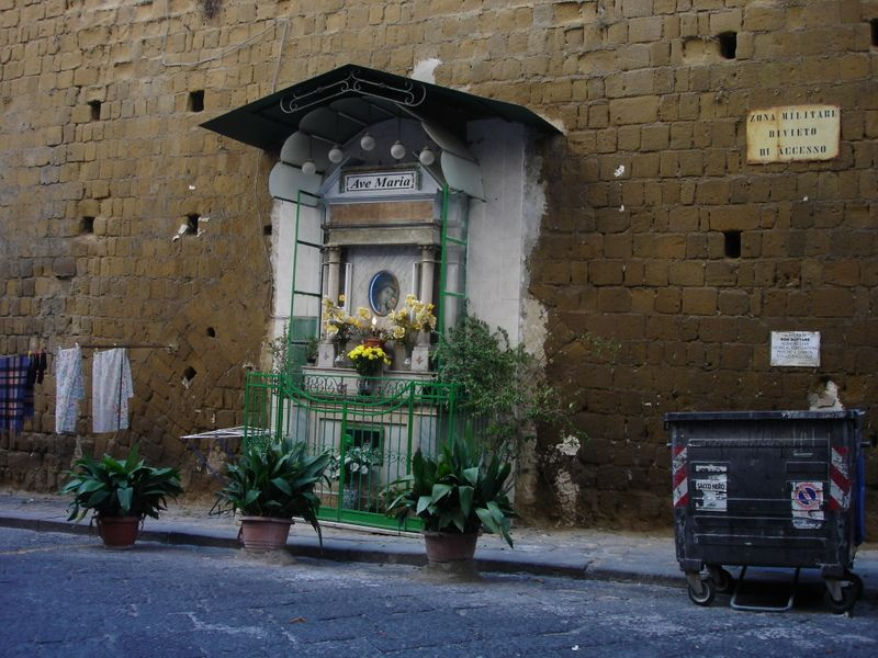 Shrine Naples Italy, together with flowers, laundry