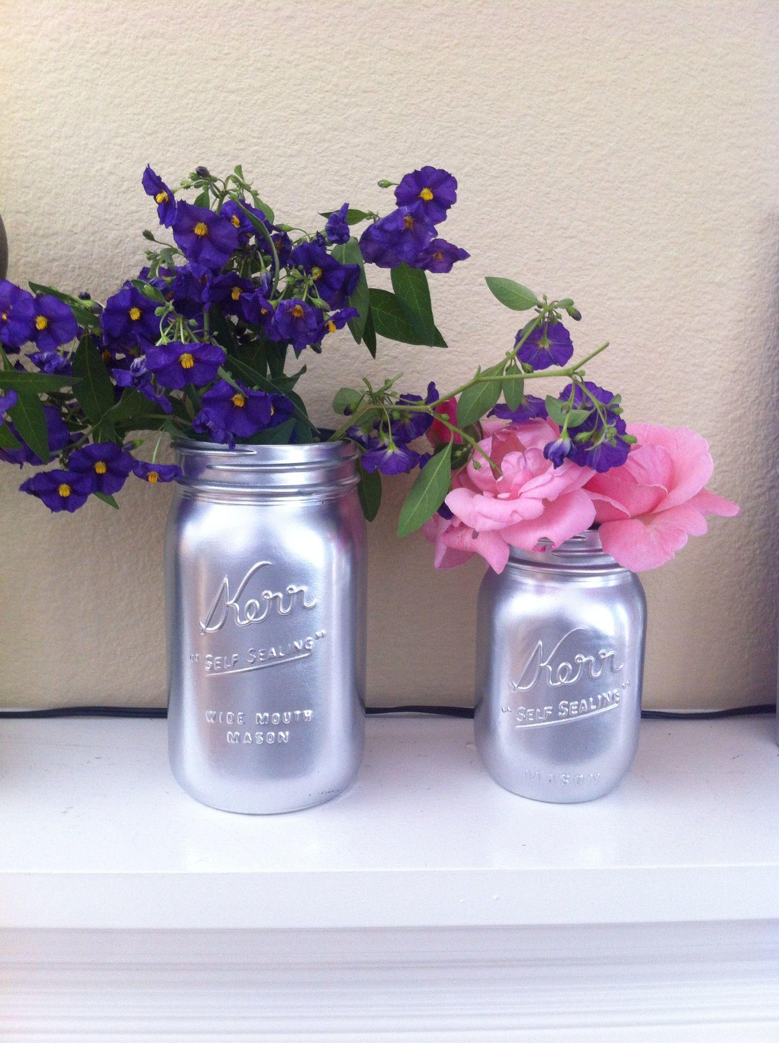 Spray painted mason jars make pretty vases