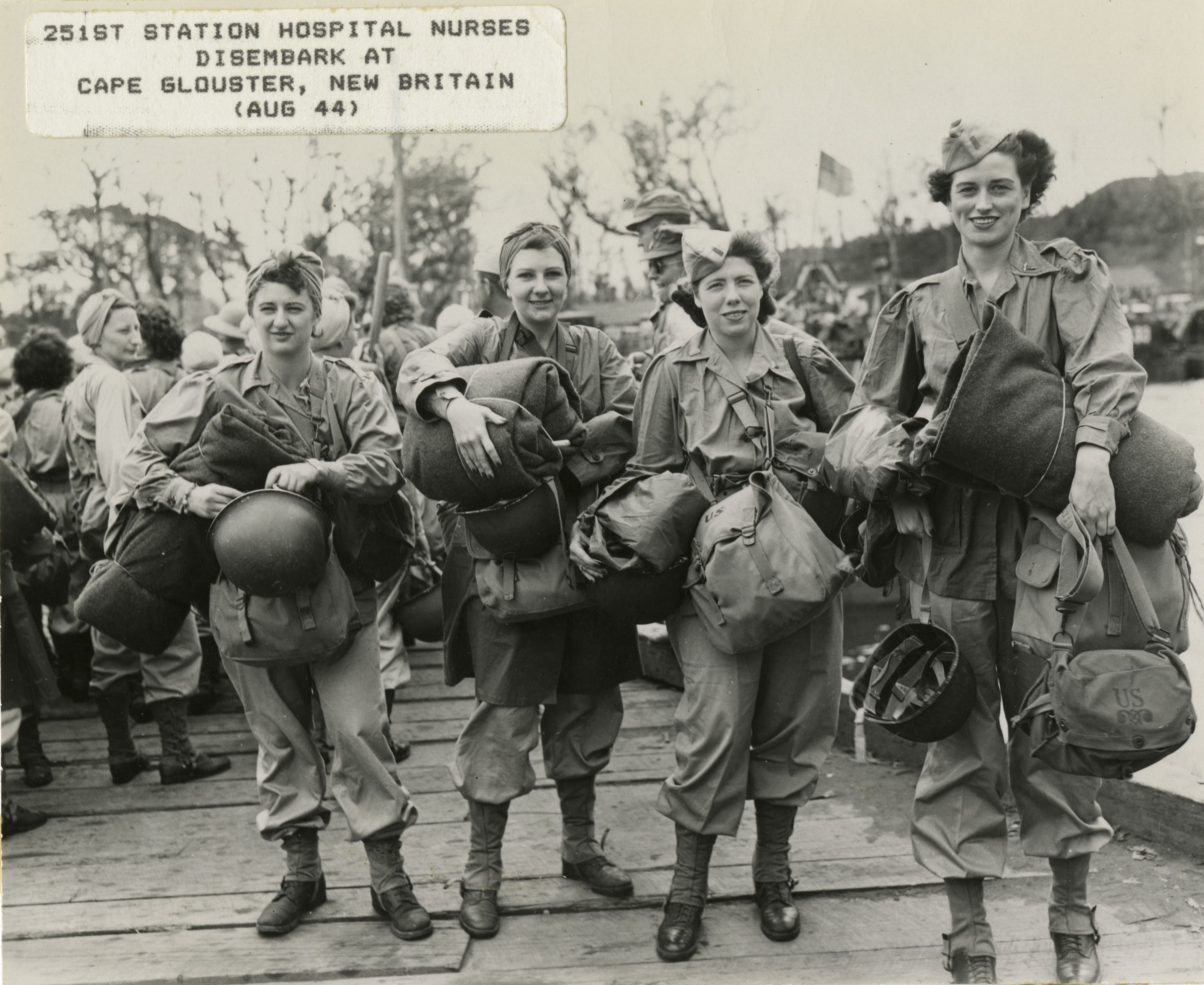 Four nurses in standard issue Army uniform carry all their