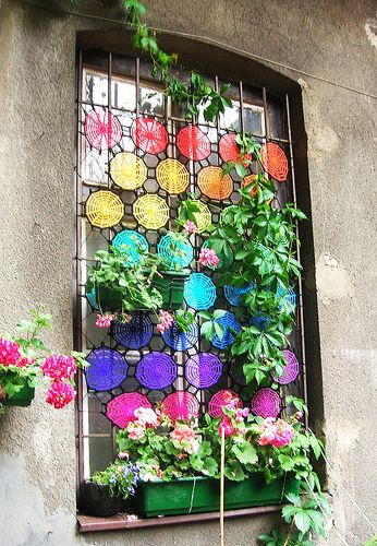 ....with a crochet window curtain - maybe inside though