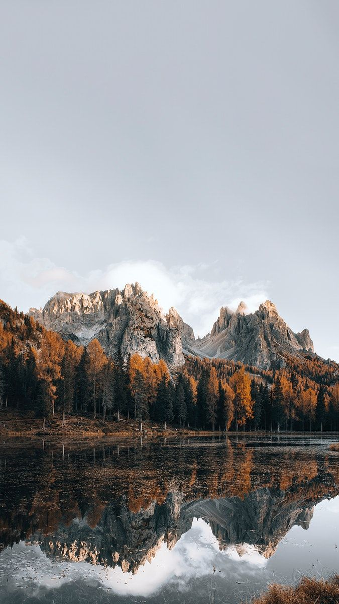 Download premium image of Dolomites lake in autumn mobile phone wallpaper by Luke Stackpoole about autumn iphone wallpaper, nature wallpaper, rock mountain, iphone wallpaper, and wallpaper 2094657