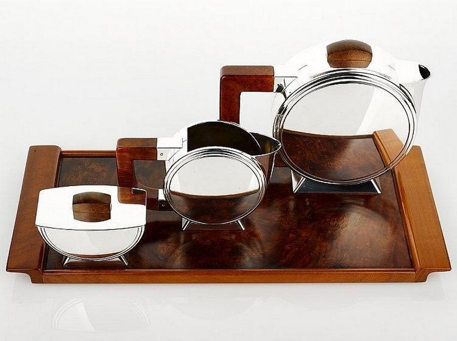 Christofle Art Deco three piece tea-set comprising tea pot, creamer and sugar bowl all marked 'Christofle France,'