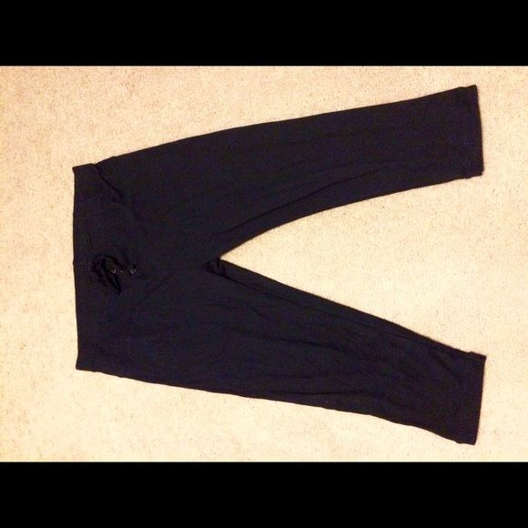 GAP NWOT navy blue cropped lounge pants Cropped GAP lounge pants NWOT size L. Mostly cotton blend w/ a little stretch in them. Super soft. Has 3 faux buttons in the front GAP Pants