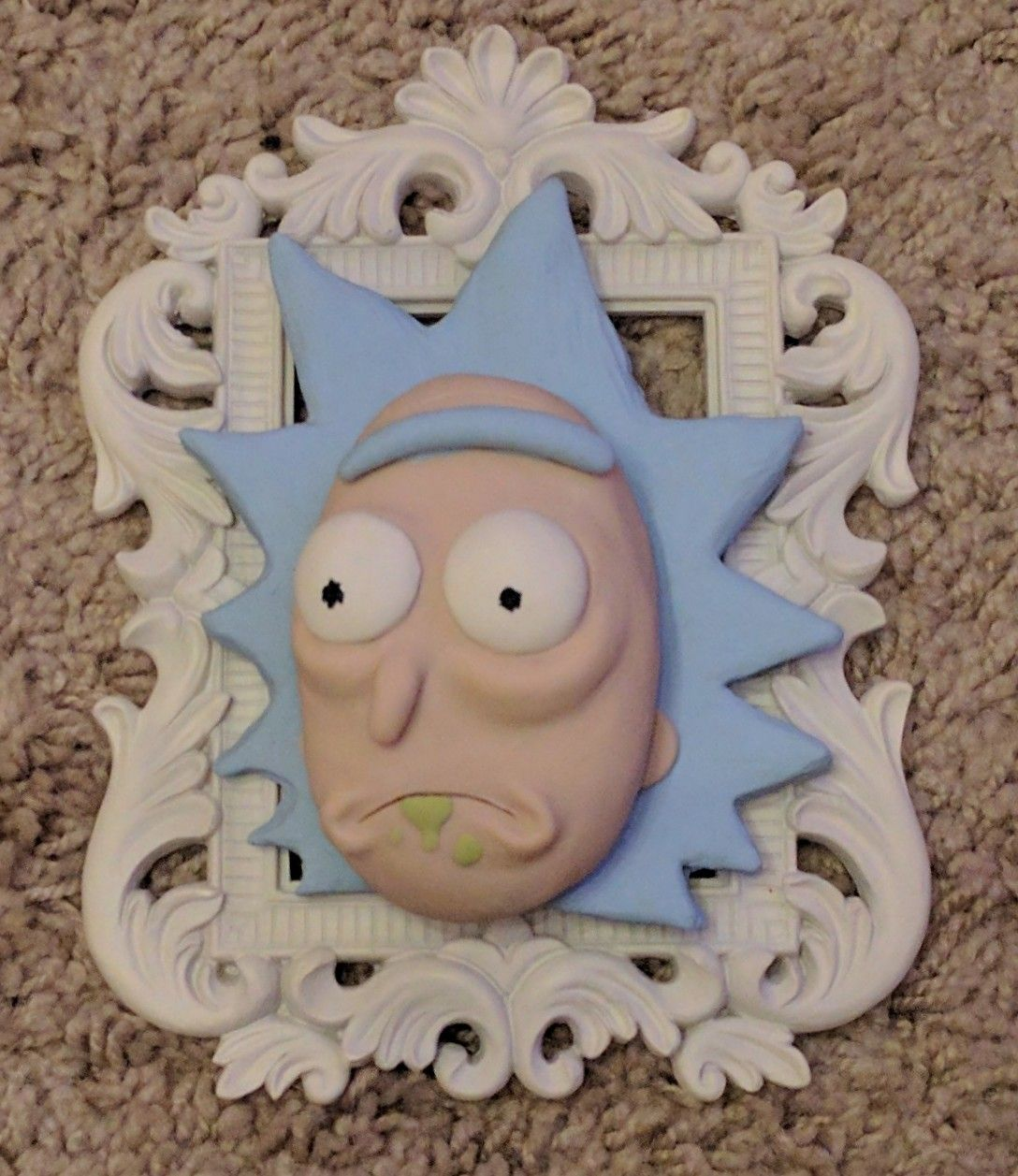 Polymer clay Rick Sanchez from 'Rick & Morty' by Kelsey Waite in ornate matte white frame.