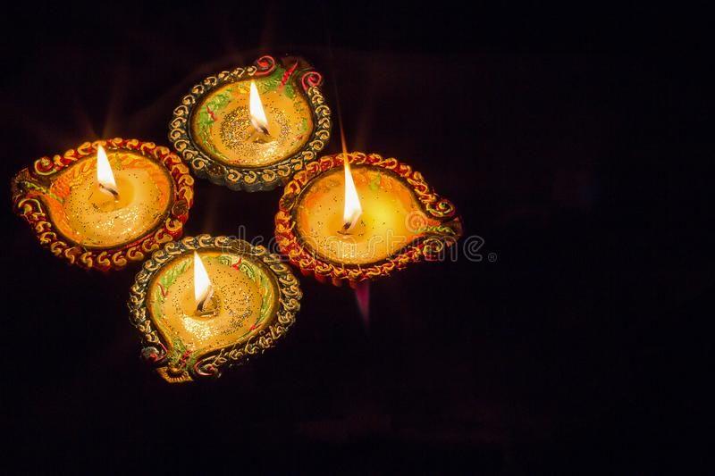 Four Burning Colorful Clay Diya Lamp Diwali Celebration Black B Ackground Ad Clay Diya Burning Colorful Lamp Diya Lamp Diwali Celebration Diwali