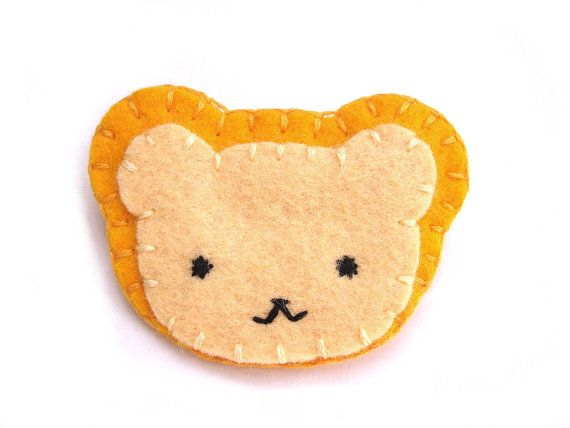 This cute yellow bear wants to go home with you! This pin in in the shape of a friendly, smiling teddy bear. Its made of soft wool blend felt in shades