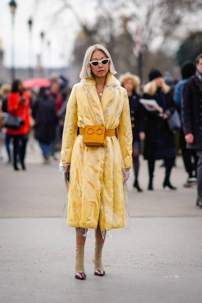 A guest wears a yellow coat a transparent plastic coat an ...
