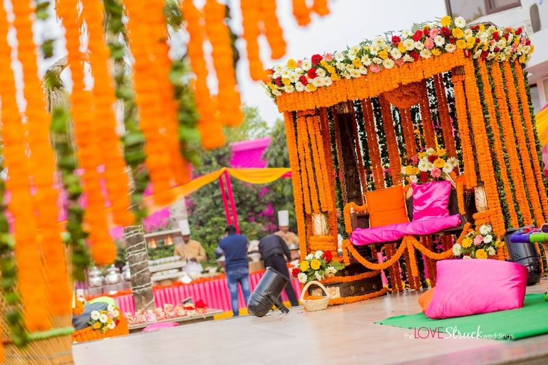 Outdoor decoration setup with clustered floral arrangement marigold outdoor decoration setup with clustered floral arrangement marigold strings and pillows weddingz junglespirit Gallery