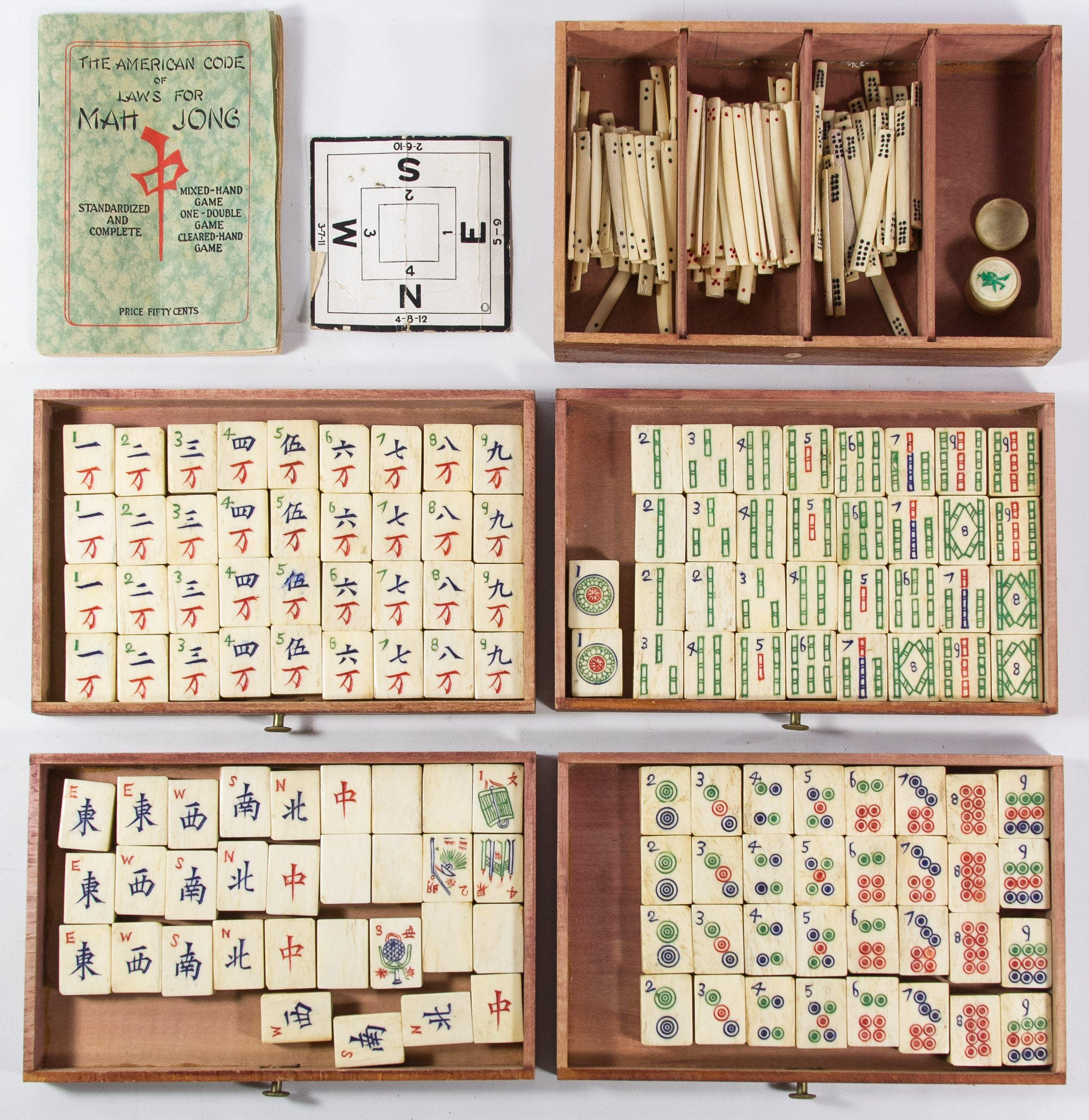 Lot 424: Mah Jong Game Set; Including a box with five drawers, playing tiles, markers and 1924 instructional booklet