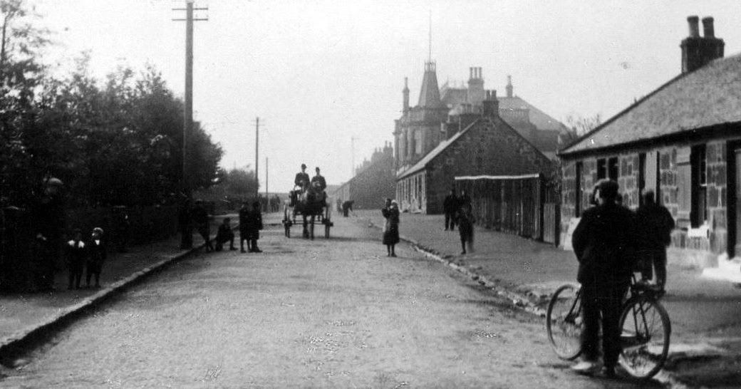 Old photograph of cottages and people at the West End of Fauldhouse in West Lothian , Scotland . Fauldhouse was known until the 19th centur...