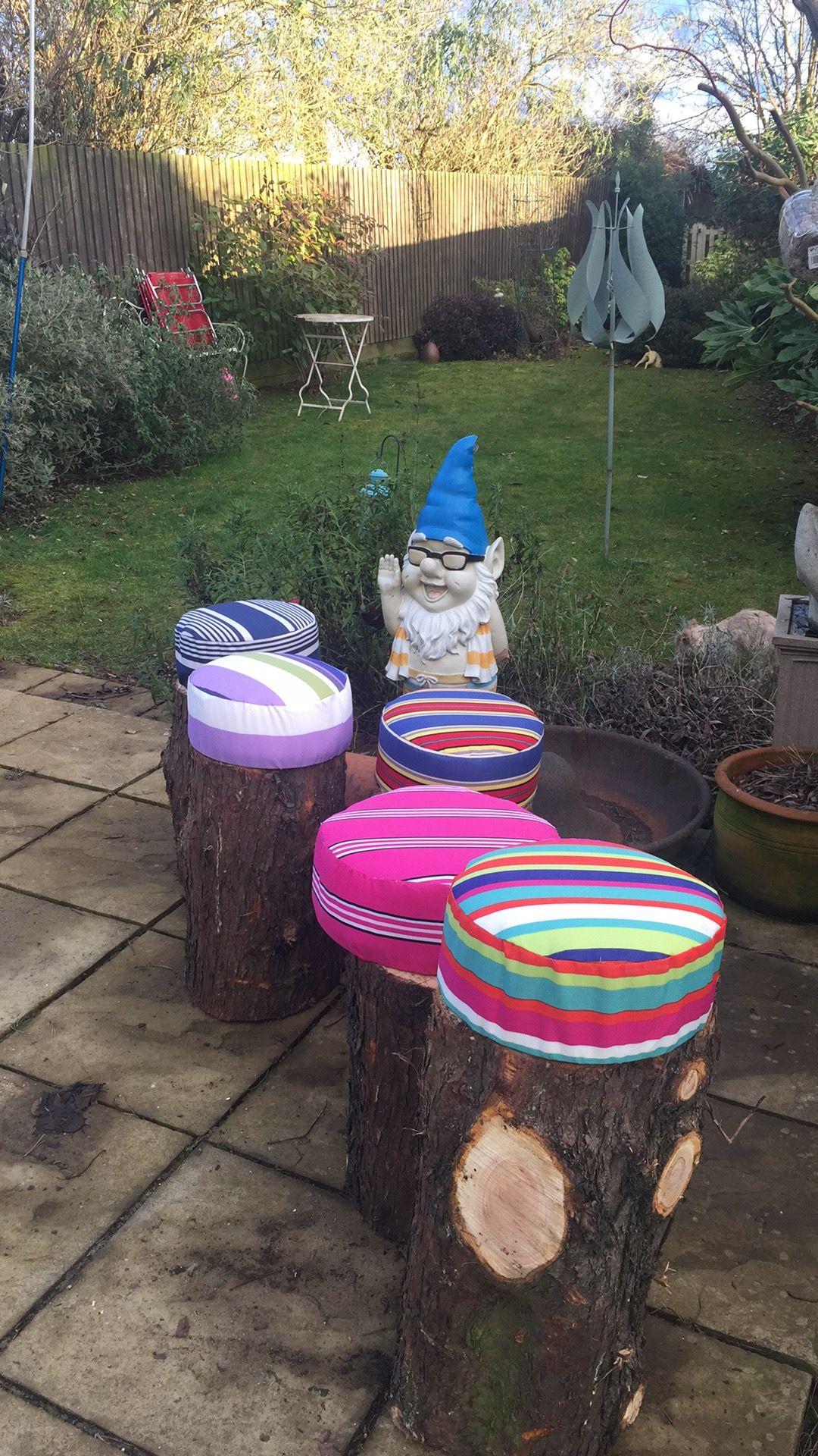 Tree stump stools. Cushions made from waterproof fabric