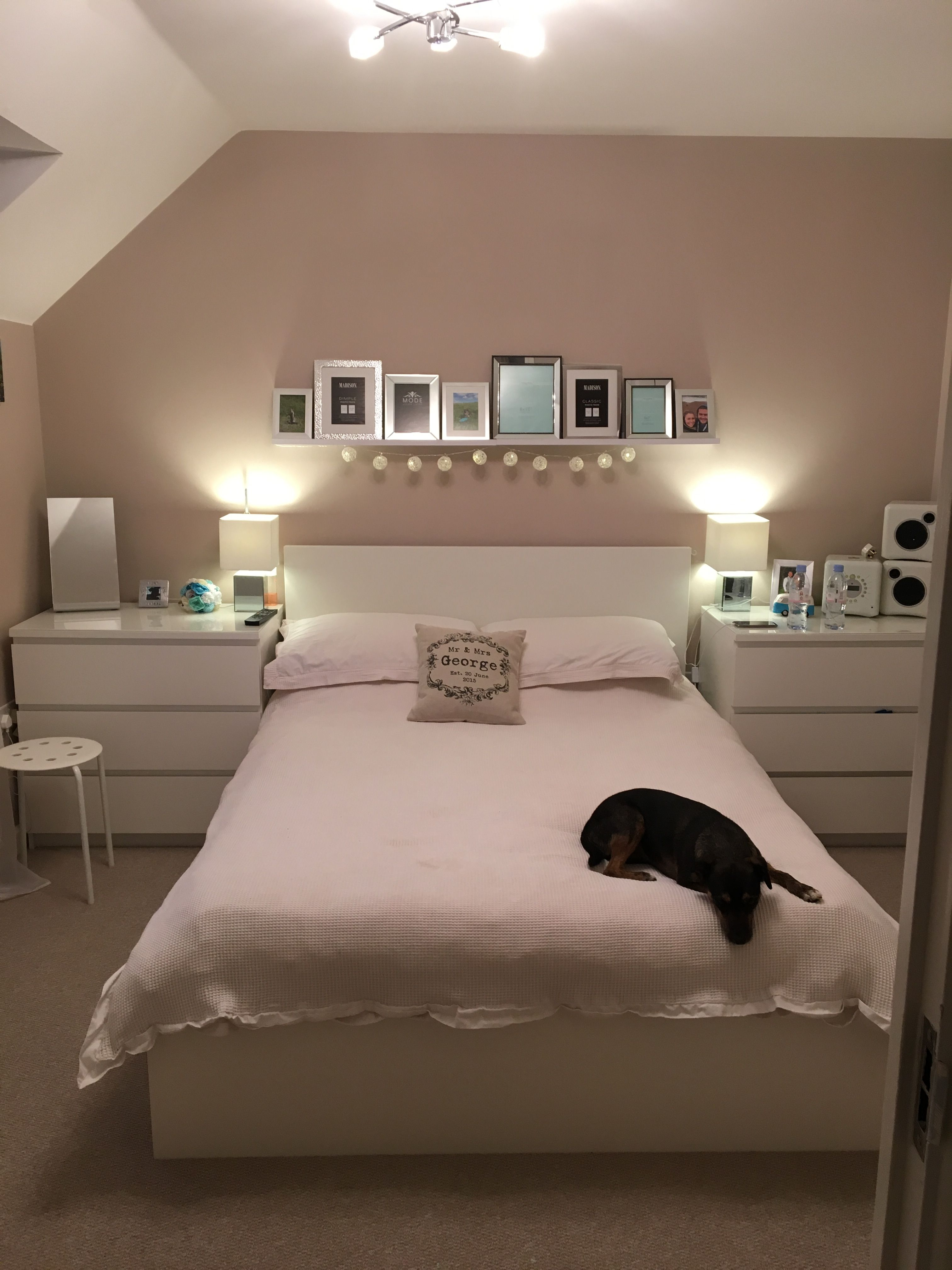 Natural Bedroom With Photo Feature Wall Tan Neutral