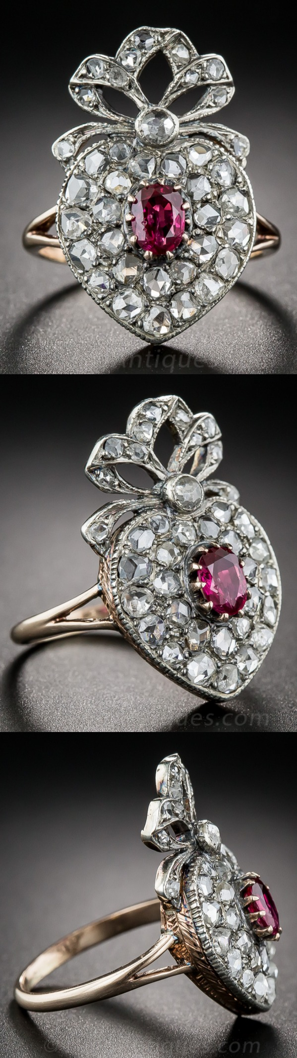 """Edwardian romanticism is in full bloom in this ravishing and regal, ruby and diamond ring - circa 1900. Measuring an impressive 1 inch minus (15/16""""), the glittering rose-cut diamond studded heart is hand fabricated in silver over 9ct. rose gold (hence of British origin), and is centered with a rich, red oval faceted ruby. A classic diamond bow crowns this rare, wonderful and very wearable treasure."""