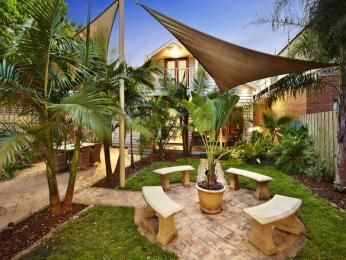 Tropical Garden Design dennis hundscheidts tropical garden best tropical gardens in brisbane the courier mail Tropical Garden Design Using Pavers With Outdoor Dining Shade Sail Gardens Photo 321205