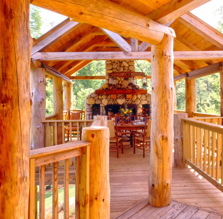 Log home deck with outside fireplace log homes inside for Log home decks