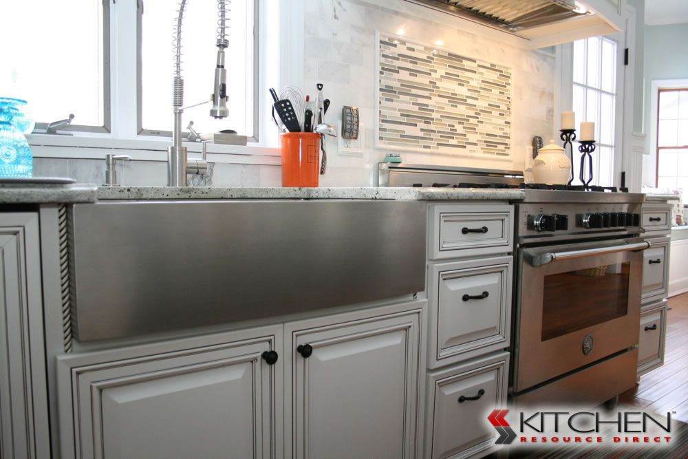 A white painted cabinet with dark glaze shown is for White kitchen cabinets with chocolate glaze