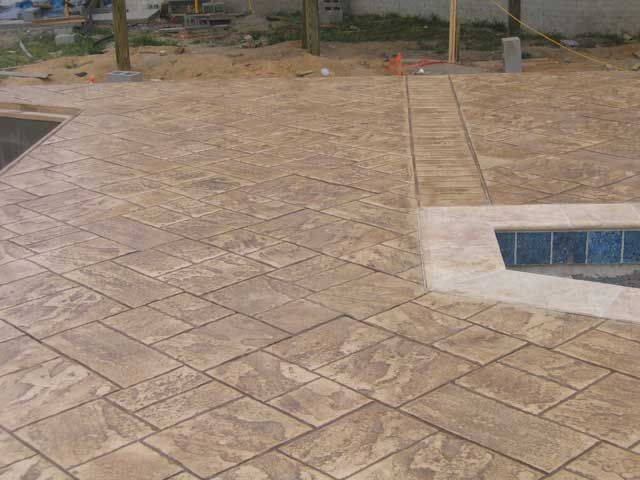 slate stamped concrete pictures around pool | dyed, stamped