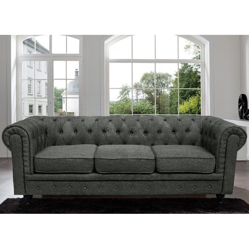 This Sofa Features Tufted Buttons With Overstuffed Cushions And A Sophisticated Linen Upholstery Chesterfield Style Sofa Best Leather Sofa Black Leather Sofas