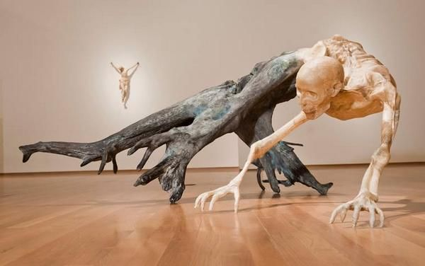 0 Javier Perez carves these crawling human skeletons to look like they are crawling out of dead trees