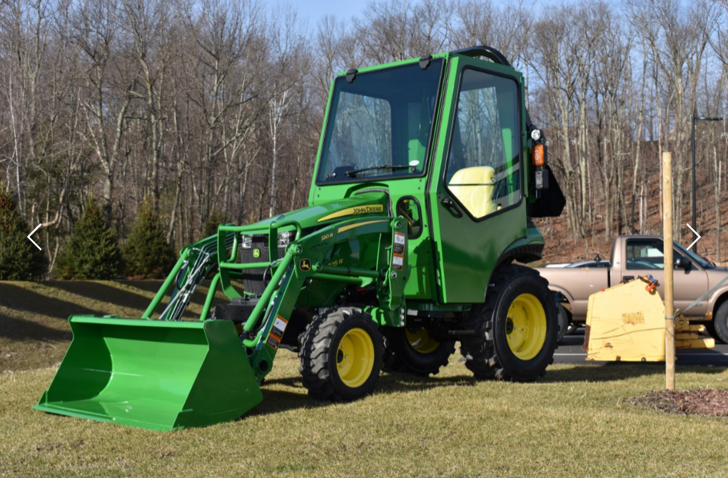 A Curtis Cab on a John Deere 2025R  Features include venting