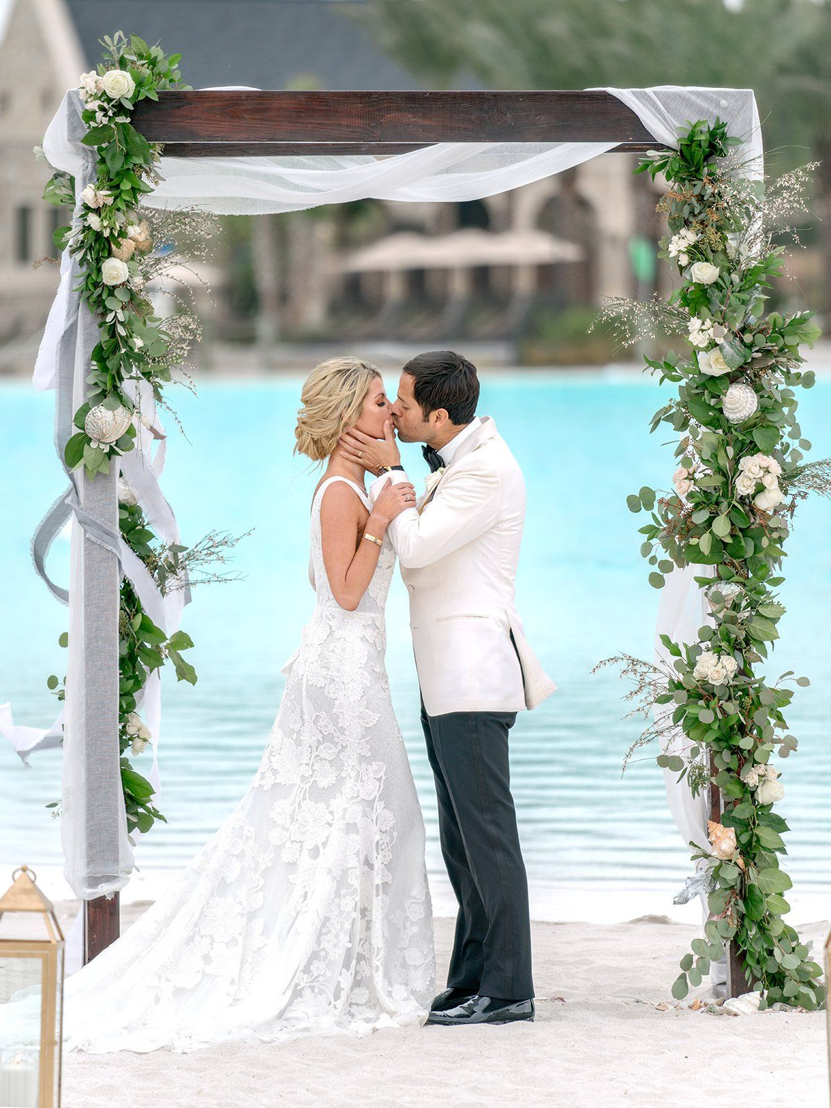 Beautiful Beachside Lagoon Wedding Ceremony Setup Floral Arch