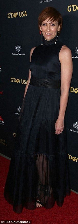 Elegant: Actress Toni Collette wore a floor-length black gown, the ruffled dress secured with a matching waist belt