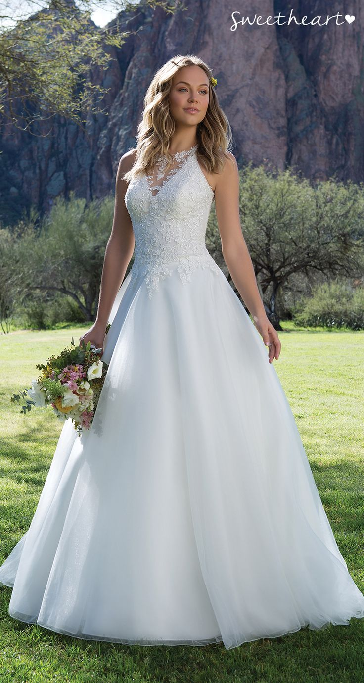 Style be flirty in this beaded lace illusion halter wedding