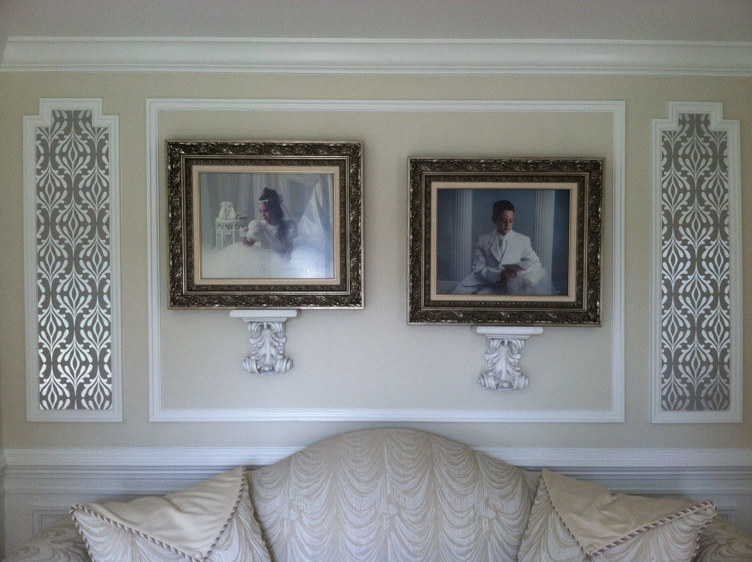 Photographs hung within molding. Use of wallpaper framed by molding ...