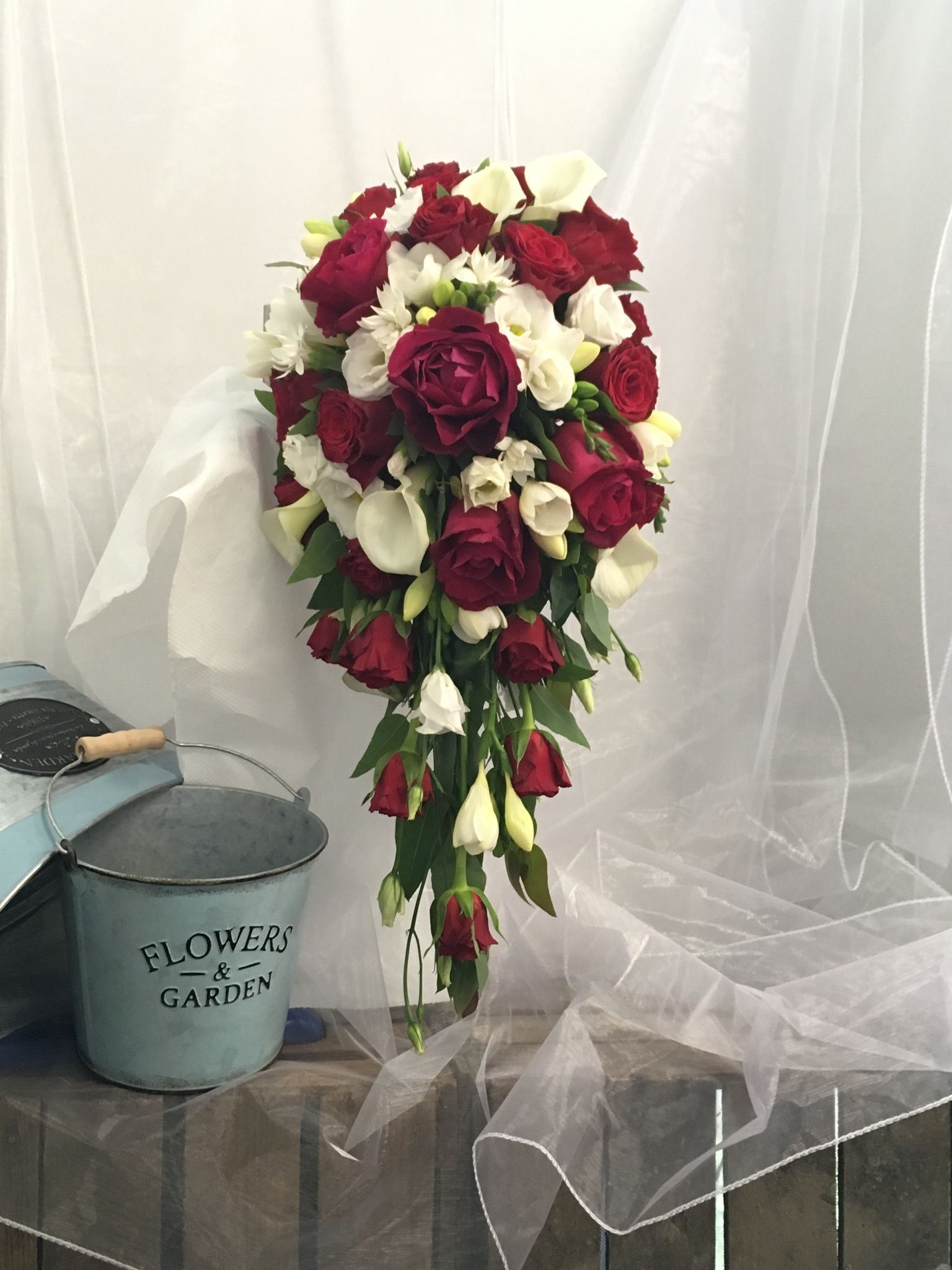 Wedding bouquets teardrop  Gorgeous red rose and white seasonal flowers brides bridal teardrop