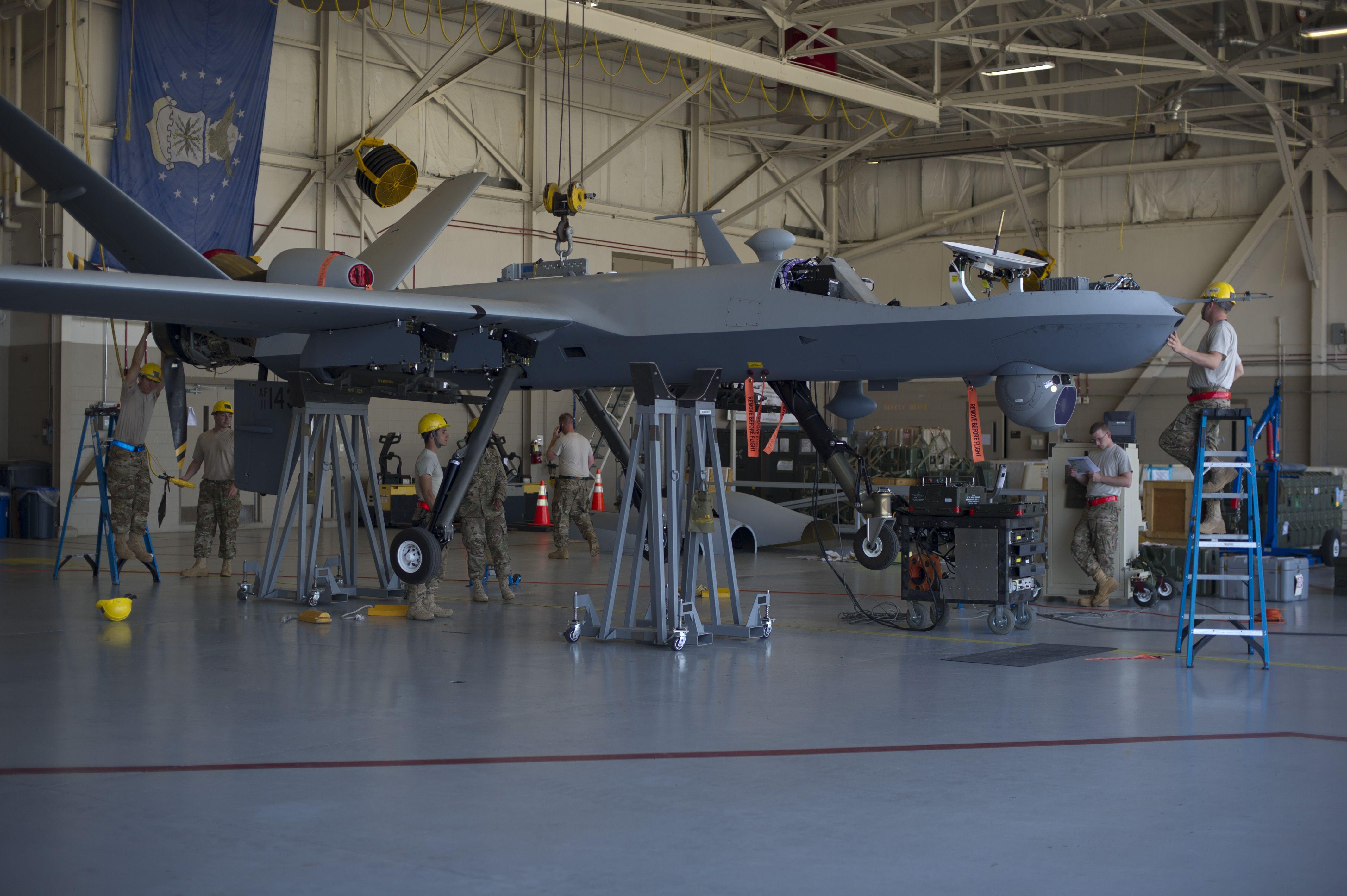 Airmen from Cannon Air Force Base assemble an MQ9 Reaper