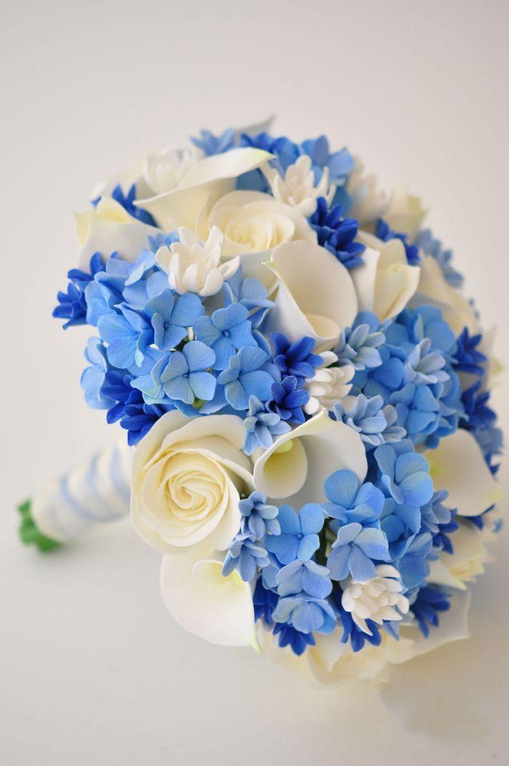Precioso ramo de novia en distintos tonos de azul para la boda champagne ivory roses ivory callas ivory tulips tuberose blue hydrangeas and blue hyacinth bouquet very very very pretty izmirmasajfo
