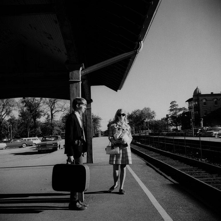 Northshore Chicago (man with suitcase on train platform), n.d.