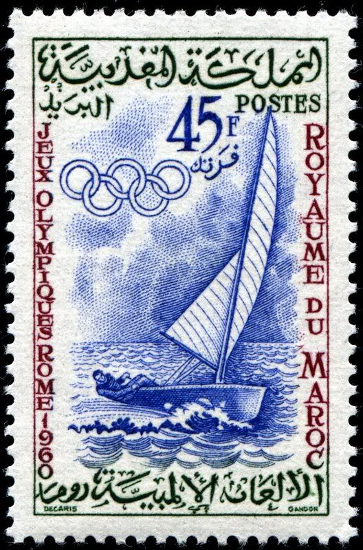 Sailboat, designed by Albert Decaris, engraved by Pierre Gandon, and issued by Morocco on September 26, 1960 to publicize the 17th Summer Olympic Games in Rome, Scott No. 51.