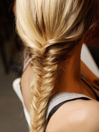 "The season's easiest mane solution? ""Try a fishtail braid,"" says Banowetz. ""It's a little unconventional, but easy to execute. Wear it on the side for extra glamour."""