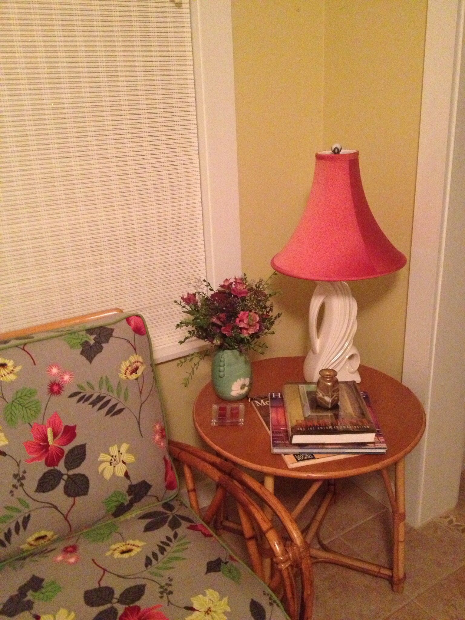 Heywood-Wakefield rattan side table with Weller vase & vintage lamp from Millie's Antiques. Vignette in the sunroom.