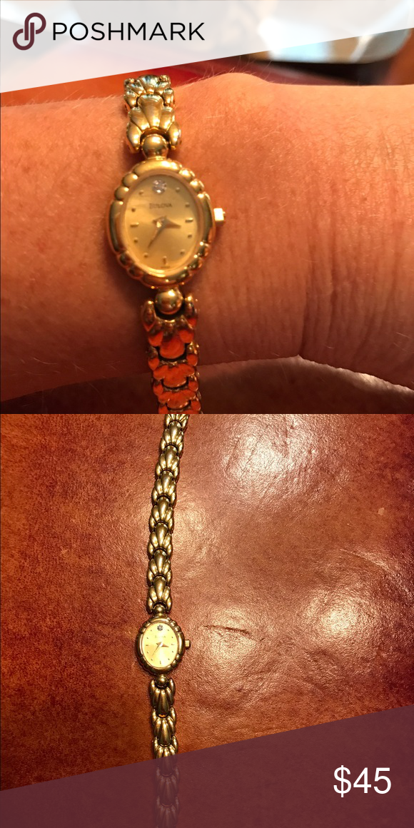 Watch Ladies Bulova watch. Gold with diamond accent at '12' .  No scratches, like new.  Two additional links for additional length Bulova Jewelry