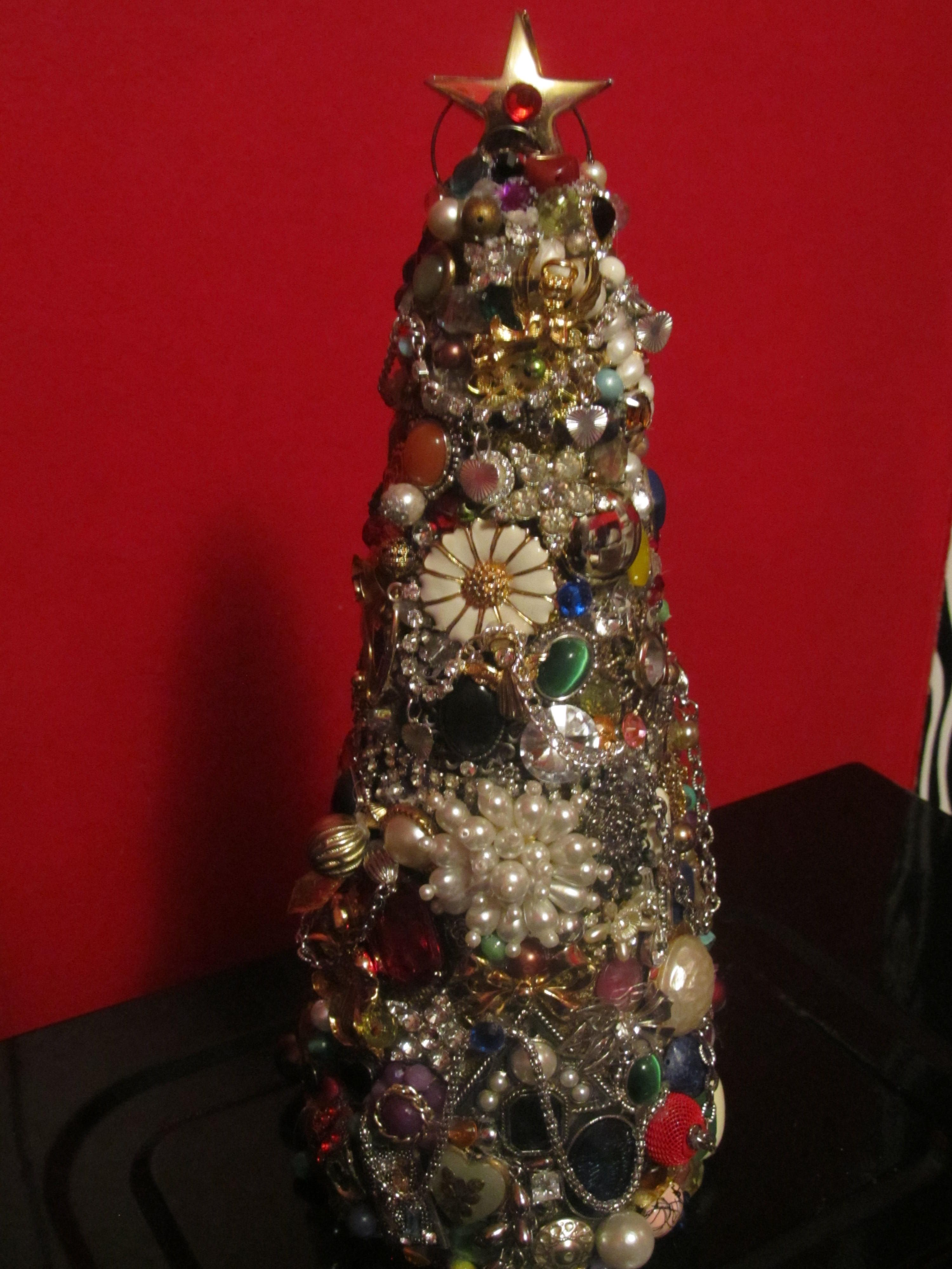 My tree made of old jewelry and rhinestones. Used a cone shaped piece of styrofoam. Use old jewelry pieces and stick into foam and hot glue to stay put.