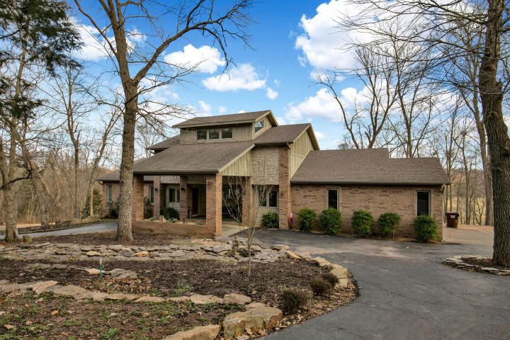 Nestled Just Off Of The Highway On A 3 Acre Lot With A Paved Circular Drive Is This Beautiful 3