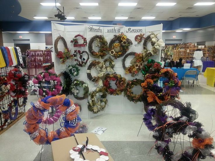 Wreath display craft fair wreaths with a reason set up for Craft wreaths for sale