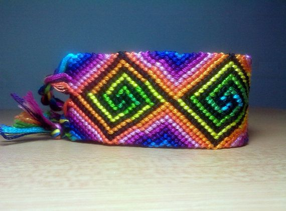 Friendship bracelet, knotted macrame psychedelic swirl in rainbow neon colors, made to order on Etsy, $26.50