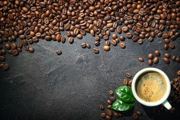 Cup of espresso with coffee beans ,
