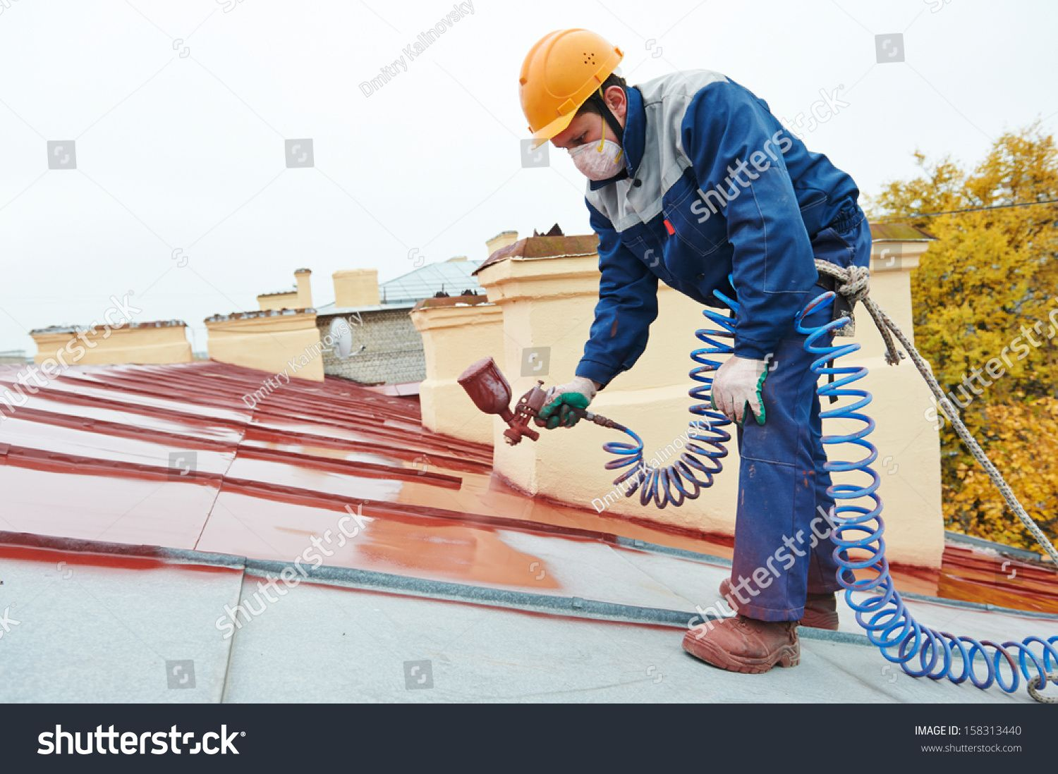 Roofer Builder Worker With Pulverizer Spraying Paint On Metal Sheet Roof Royalty Free Image Photo In 2020 Metal Roof Roof Installation Roofer