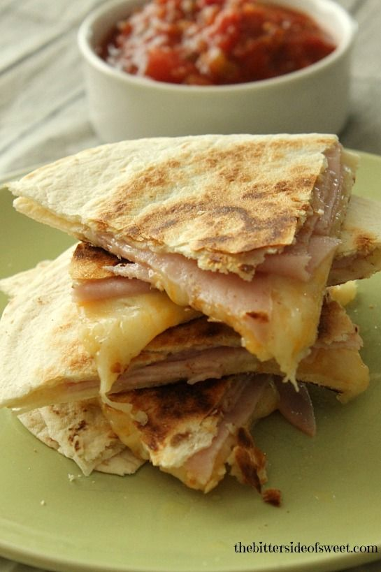 I am doing lunch just for myself or making the kids an afternoon snack I like to cook up these quick and easy Ham and Cheese Quesadillas.