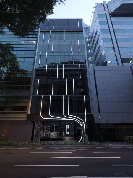 Face to face by ministry of design face facades and for Office building exterior design