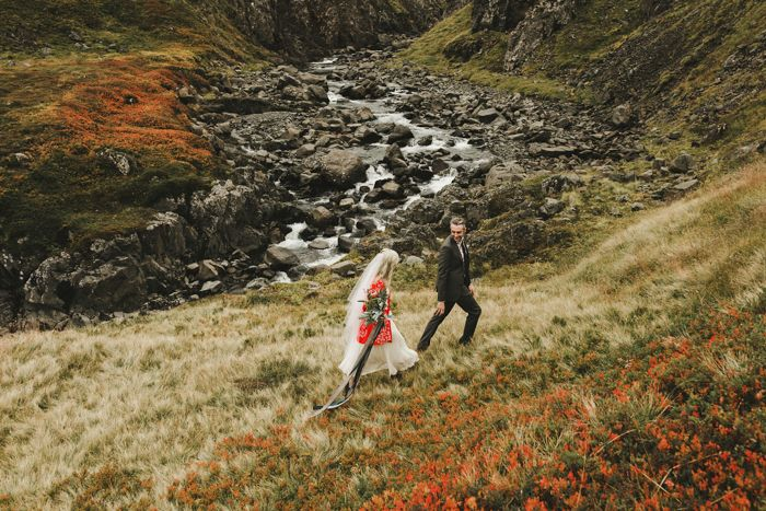 This Iceland elopement features a super cute city hall ceremony, a breathtaking film, and stunning portraiture among Iceland's mossy wilderness.