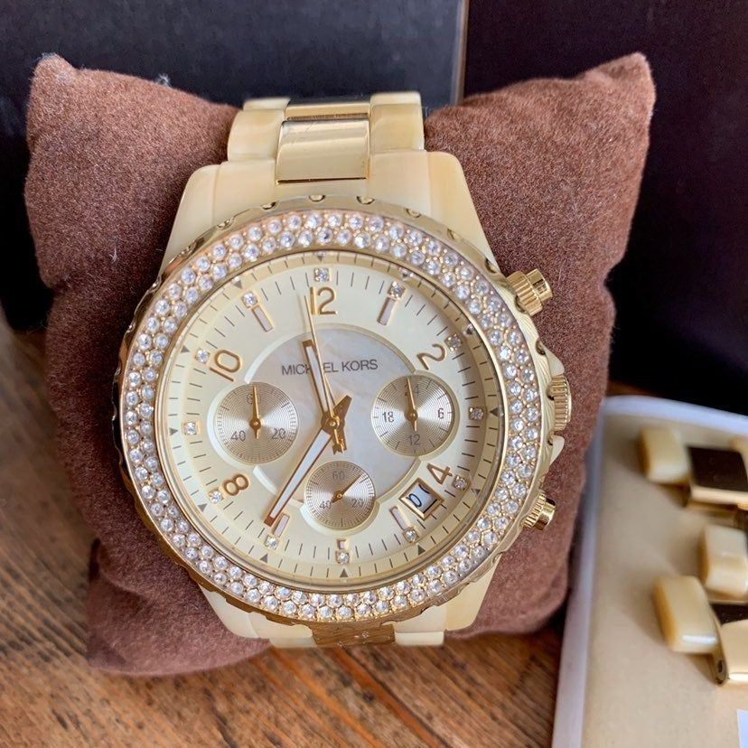 Gold and tan Michael Kors watch. Comes with box, links and