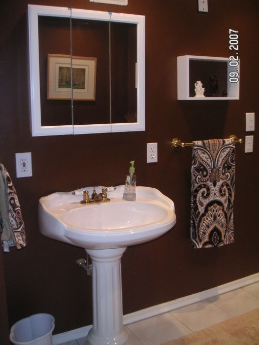 Chocolate brown bathroom build a bathroom off a bedroom for Brown bathroom designs