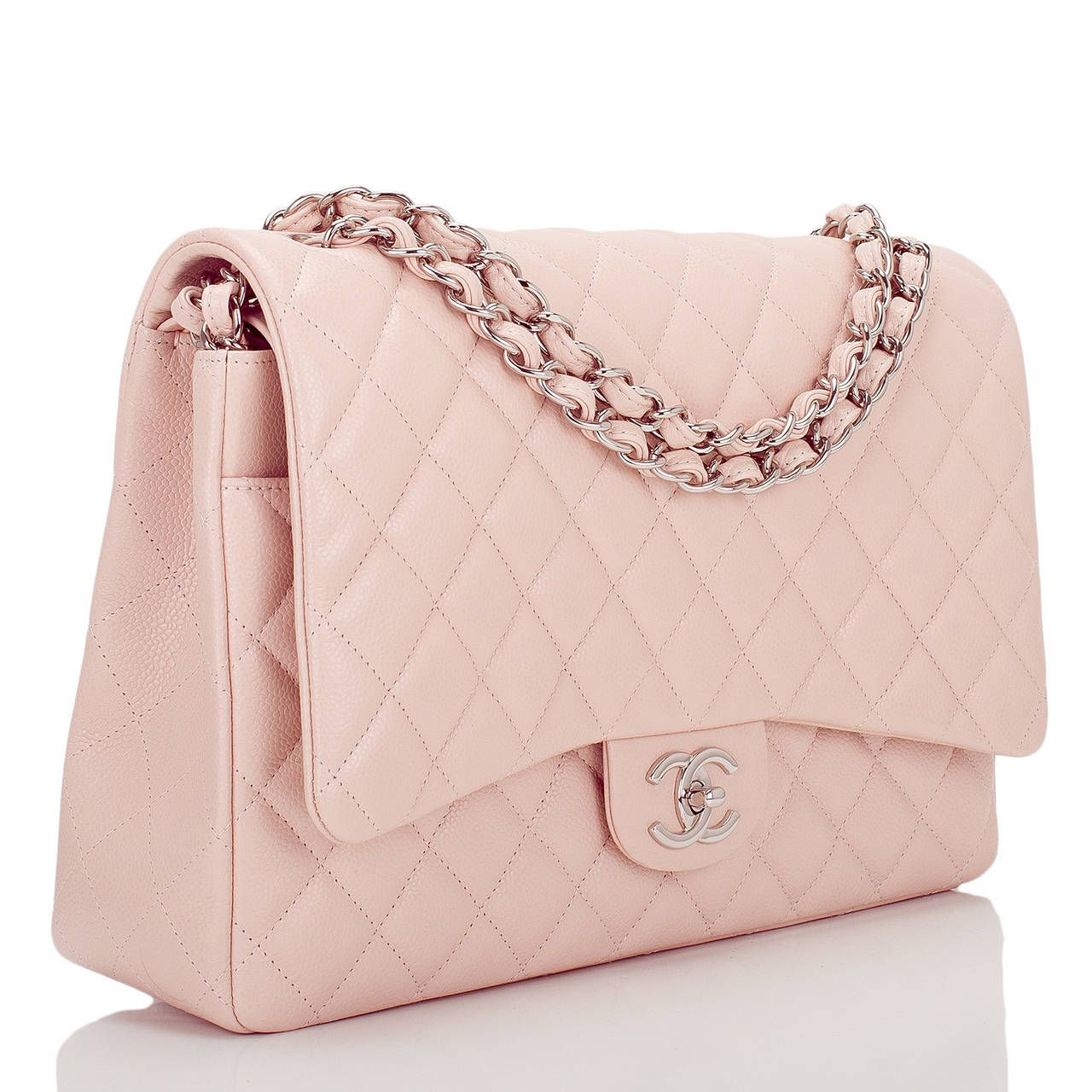 7ad8e130e0c6 View this item and discover similar structured shoulder bags for sale at -  This limited edition Chanel Maxi Classic double flap bag of light pink  quilted ...